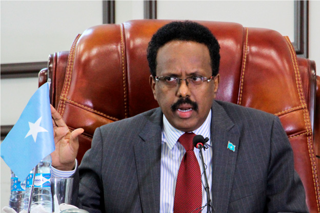 Bowing to pressure, Somalia's president drops bid to extend term